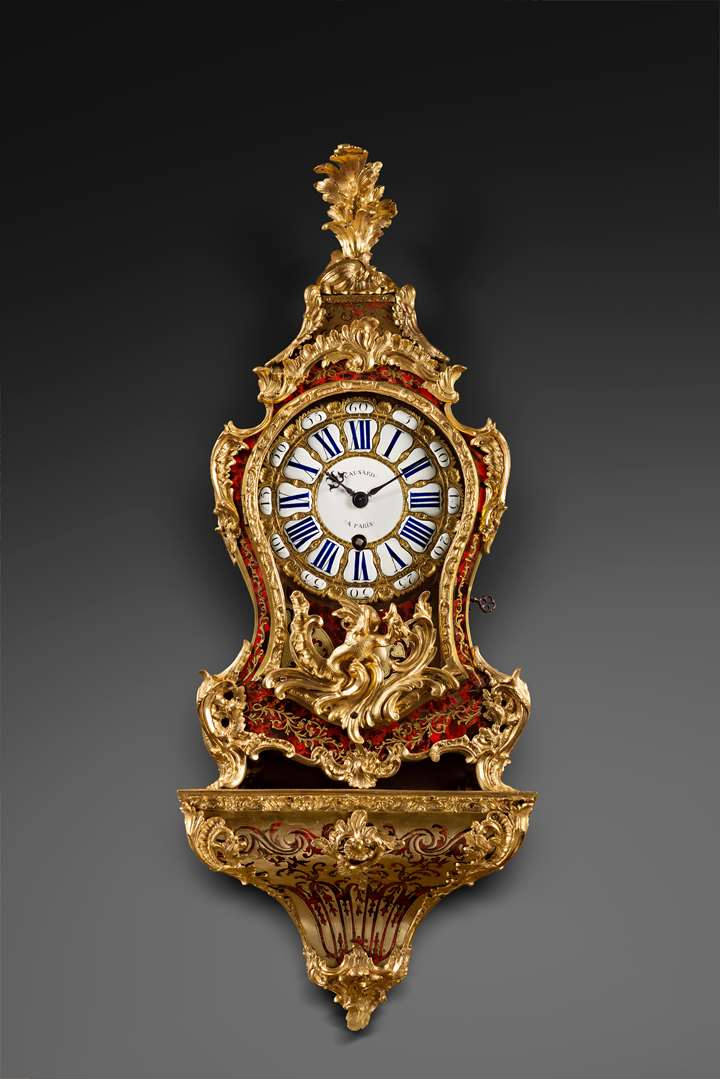 A Louis XV ormolu-mounted tortoise-shell cartel clock and bracket